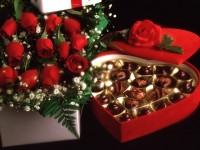 Holidays___International_Womens_Day_Red_roses_on_March_8_with_chocolates_058032_29